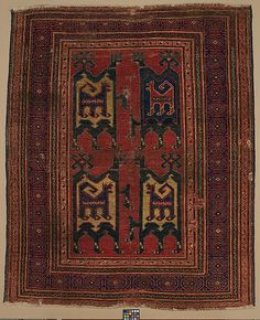 Confronted Animal Rug Object Name: Carpet Date: 14th century Geography: Turkey Medium: Wool (warp, weft, and pile); symmetrically knotted pile Dimensions: Rug: L. 65 in. (165.1 cm) W. 54 1/2in. (138.4 cm) Tube: L. 62 in. (157.5 cm) Diam. 6 in. (15.2 cm) Classification: Textiles-Rugs