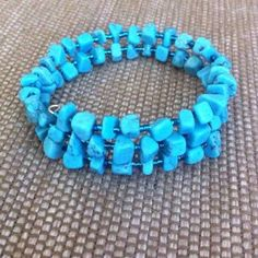 Natural Turquoise Bracelet! Natural three tiered memory wire bracelet with turquoise chips and glass seed bead spacers! Handmade by me! One left! Any questions feel free to ask!  Jewelry Bracelets