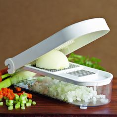 vegetable chop & measure :  If you like a bit of order when you are cooking this is the gadget that you need. dice your unions into squares and finely dice your celery,it comes with a handy measure as well should you need to be measuring what you are chopping up. www.twokitchenjunkies.com