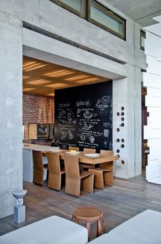 i love the ceiling treatment, chalk board wall and the wine rack. how cool...hate the chairs tho. eek