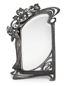 An Art Nouveau pewter figural mirror
