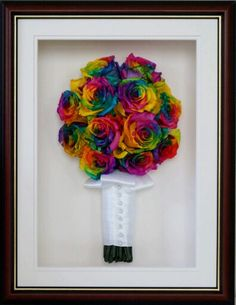Preserved and framed rainbow rose wedding bouquet.