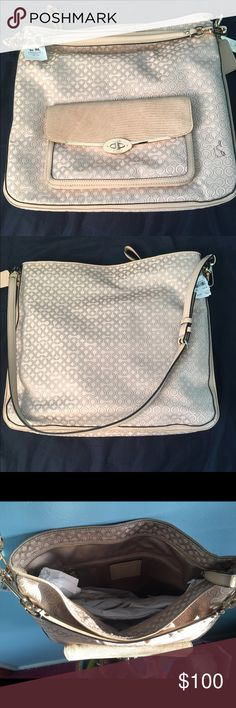 Never used Coach shoulder bag Never used coach shoulder bag! Tags are still on and comes with the coach white bag as well! Great condition just not my style :) Coach Bags Shoulder Bags