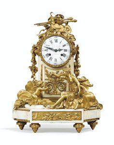 Reloj en bonce dorado y marmol blanco, estilo Luis XVI, firmado DD FC DUBOIS, Paris, cerca de 1780.Alto 41 cm. x 30 cm.