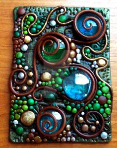 Another polymer clay ACEO made with glass gems and accented with Pearl Ex powdered pigments and solid brass filligree leaves. Check out my items for sale at www.MandarinMoon.etsy.com I own the copy...