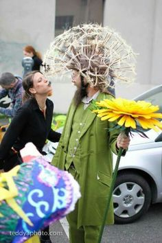 "Witty Dandelion Costume ~ I love that the girl is trying to blow away the white wispy ""blooms"", that we, as children, would always do to real dandelions!  :)"