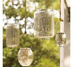 DIY mercury glitz on garden lanterns made from recycled glass jars