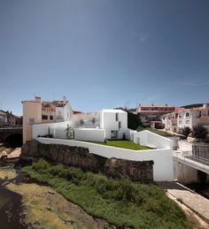 Completed in 2011 in Alcobaça, Portugal. Images by Fernando Guerra | FG+SG . The house designed in the historical center of Alcobaça is a record of overlapping times: A small building reconstructed to perpetuate the vernacular...