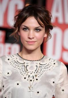 Alexa Chung - loose up-do, love the make-up too