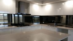 This mirrored glass splashback is called Reflections and gives this perth kitchen the Wow factor. www.asplashofglass.com.au