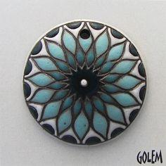 Golem Studios: sun design in light dark blue on terracotta