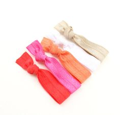 I love these Elastic Ponytail Holders  Snag Free Hair Elastics  by preppypieces, $7.00.  Great patterns and colors.  Wear them all the time.