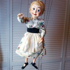 """EN: Arriving at Puppet Palace (my home) this week is #305_Cinderella Maiden """"A blond 'Poor Cinderella' who sits by the fireside in a print dress, black bodice, white apron and low heeled shoes."""" Quote from 1953 Hazelle's Marionettes product brochure. ES: Al llegar a mi casa esta semana es la Cenicienta. Ella fue hecha por Hazelle's Marionettes en Kansas City."""