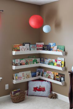 love this idea of gutters as bookshelves for Roman!