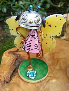 Check out this item in my Etsy shop https://www.etsy.com/uk/listing/273386422/trixx-hand-made-fairy-robot-from