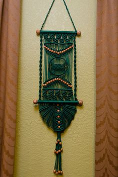Green macrame wall hanger