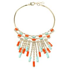 Perfect for a party or afternoon on the town, this golden brass bib necklace showcases sparkling Austrian crystals and faux turquoise and coral-hued stones. ...