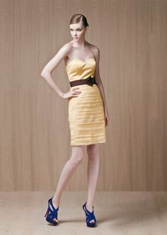 Short strapless sweetheart dress with ribbon belt at waist. not into the color of the belt