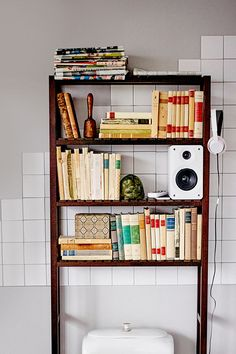 make the most use of your bathroom space with molger open storage shelf stand just reach up for your favorite music your tablet or a good book