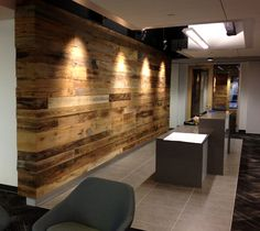 Wire brushed antique barn siding brings character to the office headquarters for a business in Washington state.