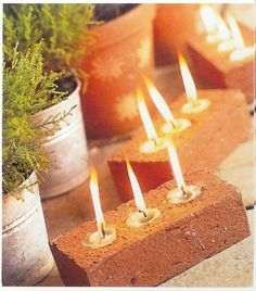Light It Up: Tips For Outdoor Lighting  Make or sticks some candles in the frogs of your leftover bricks and you have a charming table centerpiece or path lighting for your moonlight party.