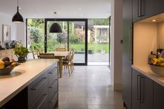 David Mikhail Architects - grey unit and limestone worktop