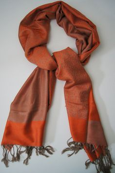 This favorite has a classy look that is evident from a mile away! Made of a cashmere-silk blend, this scarf's beautiful sheen separates it as a superior quality accessory. You will also love the soft feel of the cashmere wool against your skin. Available in blue, fuchsia, beige, orange, gray, red and brown. 70% Cashmere 30% silk. #scarf #scarves #fallscarves #giftsforhim #giftsforher #gifts #holidays #gifting