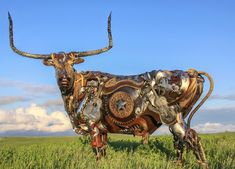 Bits of Scrap Metal Welded Together Into Powerful Sculptures: Bronze sculptor John Lopez builds large and powerful beasts completely out of metal. From buffalo to cowboys on horseback, Lopez welds layer by layer of iron together to form life-sized creations filled with interesting details and texture.
