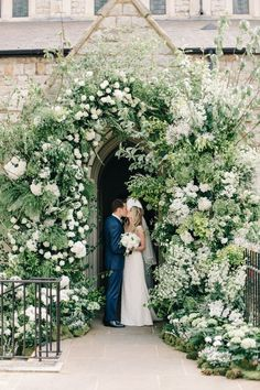 chapel entry decorated with kush greenery and white blooms