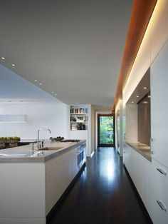 White Kitchen1 Seamless Transition Between Environments: The Fluid Home By Robbins Architecture