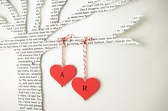 Tree made from lyrics of your wedding song;  hearts with couple's initials.  (Etsy)