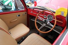 neutral leather seat with red trim. by Chappells10, via Flickr