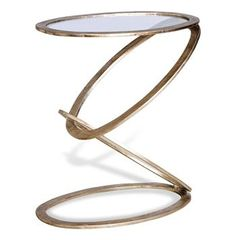 Contemporary, sculptural, and transitional- this floating circular silver leaf side table defies gravity and looks great used as a facing pair. Constructed from iron, and hand finished with silver leaf applique, the top boasts a glass surface, and is modern with a sculptural elegance.
