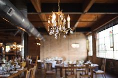 #lighting, #chandelier  Photography: Averyhouse - www.averyhouse.net Reception Venue: Salvage One - www.salvageone.com/home.php  Read More: http://www.stylemepretty.com/2015/02/25/romantic-summer-chicago-wedding-at-salvage-one/