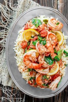 Garlic-Tomato Shrimp Recipe with Orzo. An all-star easy meal! Prawns bathed in a sauce of white wine, lemon juice, garlic and tomatoes over orzo pasta!