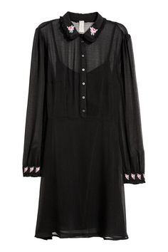Check this out! Short dress in airy, crinkled fabric. Ruffle-trimmed collar with embroidery, button placket, concealed side zip, and a seam at waist. Long puff sleeves and ruffle-trimmed, embroidered cuffs with buttons. Jersey liner dress. - Visit hm.com to see more.
