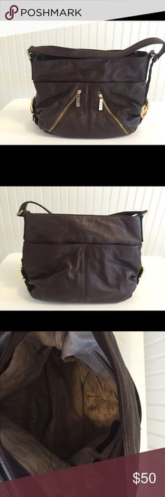 Michael Kors Shoulder Bag Authentic brown leather Michael Kors shoulder bag. Some pen marks and minor staining on interior lining. Normal wear on leather exterior. Michael Kors Bags Shoulder Bags
