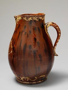 American earthenware pitcher; Redware with slip decoration. 1821