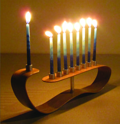 This contemporary Menorah by Aaron Z is made of laminated bamboo with aluminum candle holders and recycled non-skid rubber pads. It is a simple merging of contrasting materials in a light and fluid form. Hanukkah Menorah, Hannukah, Happy Hanukkah, Ceramic Mugs, Ceramic Art, Candle Stand, Candle Holders, Menorah Candles, Arte Judaica