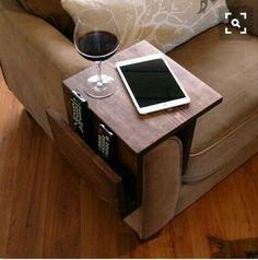 Wood shelf fits over sofa arm, pocket for remotes