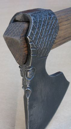 Dragon Axe - Viking Pattern Axe shape with Elmer's original Dragon ornament carved and chased into the axehead. Artist Elmer Roush