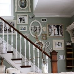 photo collage on stairs… should I do white? to break from the silver? white to match the trim and railing