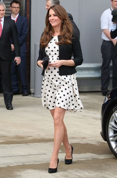 To celebrate Kate going into labor, let's reminisce about her outfits throughout her pregnancy - Kate, the Duchess of Cambridge, attends the inauguration of Warner Bros. Studios Leavesden near London on Friday, April 26, 2013. -  Kate wearing a polka-dotted Topshop frock and black Ralph Lauren jacket.