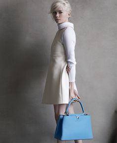 The structured yet soft silhouette of Louis Vuitton's  Capucines Handbag in bleuet is enough to make it your new favorite designer bag. | Michelle Williams
