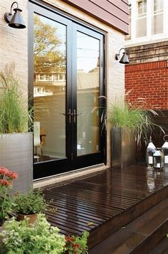 Increase Energy Efficiency with replacement doors anywhere in your home! - French Doors onto small patio with grasses in planters - Lisa Murphy's backyard by architect Gillian Green via House & Home Backyard Door, Backyard Landscaping, Landscaping Ideas, Deck Patio, Sunken Patio, Patio Stairs, Basement Stairs, Pergola Ideas, Backyard Ideas