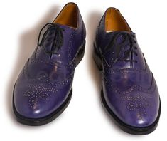 Diversify the variety of shoes in your collection by investing in Men Purple oxford Leather shoes. The pair of shoes comes in an oxford brogue style with a snazzy wingtip.