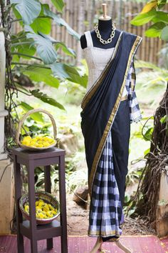 Fill your season with striking checks! This versatile half and half monochrome Gadhwal silk saree works effortlessly for a pulled-together silhouette. The magic is in the details they say - and so it is with the kundan edging given to this saree.   Strike boldly out by pairing this with strappy a corset blouse or a long blouse in any style. Or traditionalise it a bit with a U neck blouse and jasmine in your hair. #houseofblouse #festive #saree #puresilk #blouse #indianwear #india #fashion…
