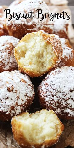 Pile of Biscuit Beignets with one cut in half to show the soft, fluffy inside.