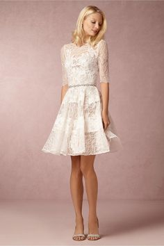 With a delicate V back, and a fun skirt, this delicate vintage lace wedding dress from from BHLDN is modern, and romantic!