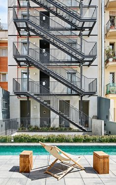 Our concept of al fresco living is not limited to just the country or the beach. Enjoy casual & urban lifestyle inspired by our Trenza Outdoor lounge chair. Stairs Architecture, Architecture Details, Barcelona Hotels, Barcelona Spain, Future Buildings, Office Buildings, Fire Escape, Staircase Design, Stairways